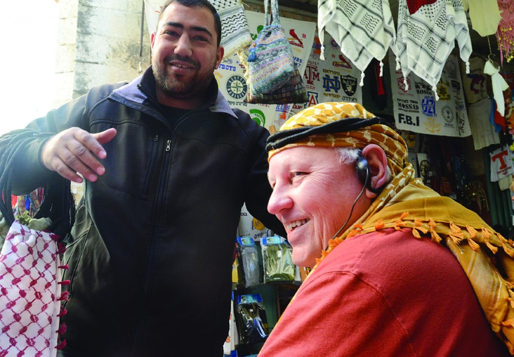 Bazaar – IBSA's Joe Gardner tries on headgear at a market stall in Jerusalem. On closer inspection, the vendor also sells souvenirs for Notre Dame, Texas A&M, and the St. Louis Cardinals, among others.