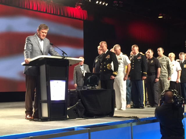 Steve Gaines prays for America following a recognition of veterans Tuesday morning prior to delivering his presidential address.