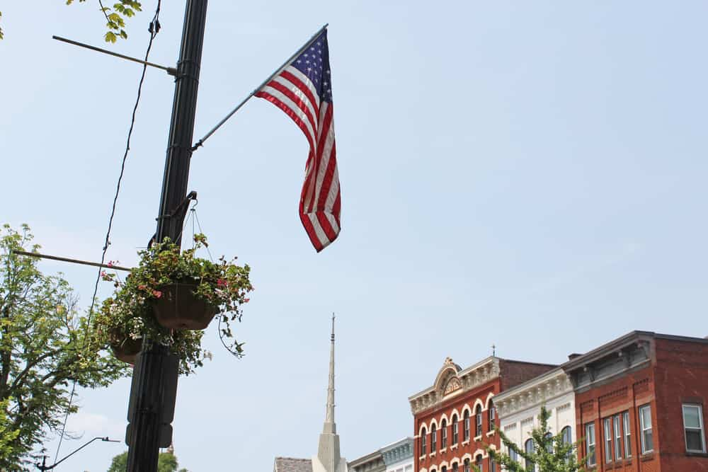 Flag with church steeple in the background