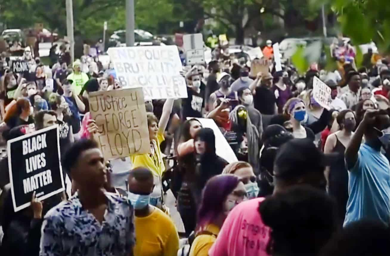 Protestors marched May 26 from the scene of George Floyd's encounter with police to a Minneapolis police precinct station.