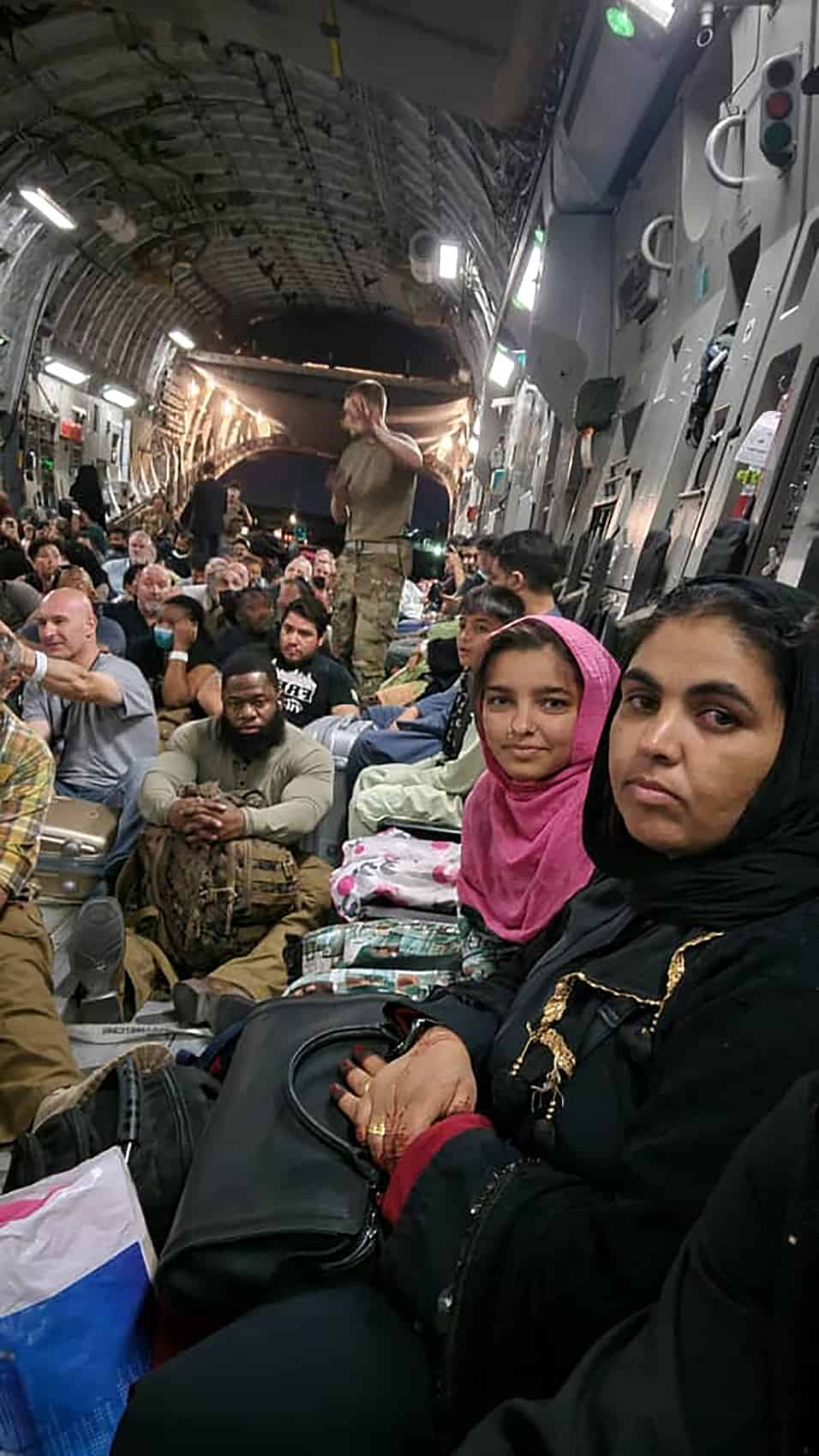 Ali's family escaped Afghanistan aboard a military cargo plane; so far, the U.S. has evacuated 95,000 people.