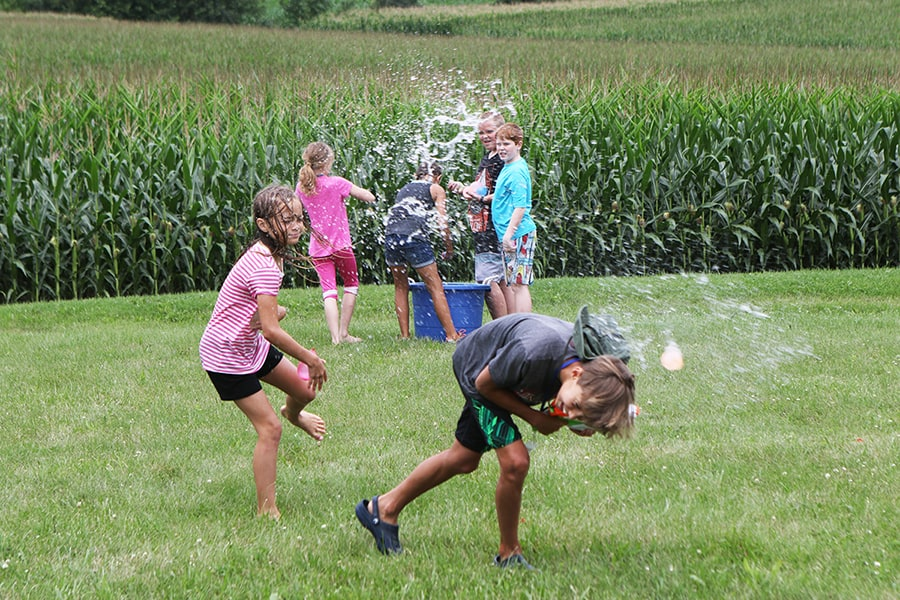 Water fight fun at summer camp.