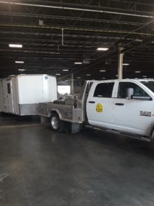 IBDR truck and trailer unloading supplies for Afghan refugees at O'Hare airport in Chicago.